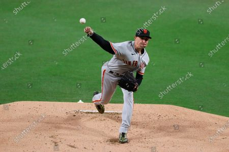 Stock Picture of San Francisco Giants starting pitcher Aaron Sanchez (21) deliver a pitch against the San Diego Padres in the first inning of a baseball game, in San Diego