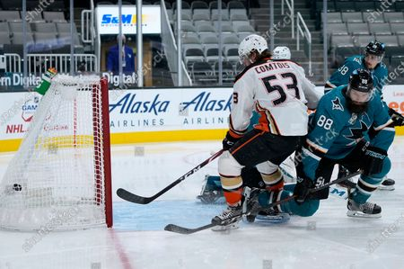 Stock Image of Anaheim Ducks left wing Max Comtois (53) scores a goal past San Jose Sharks defenseman Brent Burns (88) during the second period of an NHL hockey game, in San Jose, Calif