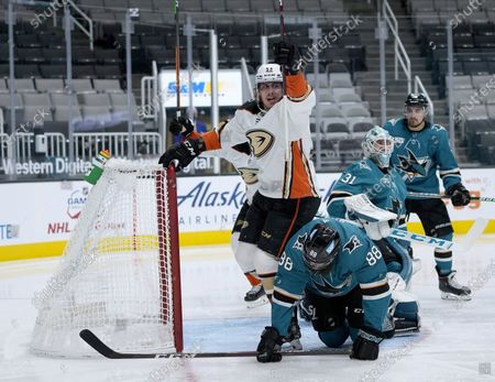 Anaheim Ducks left wing Max Comtois (53) celebrates after scoring a goal past San Jose Sharks goaltender Martin Jones (31) and defenseman Brent Burns (88) during the second period of an NHL hockey game, in San Jose, Calif