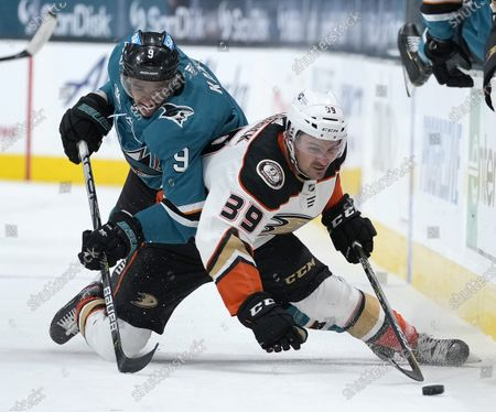 San Jose Sharks left wing Evander Kane (9) vies for the puck against Anaheim Ducks center Sam Carrick (39) during the second period of an NHL hockey game, in San Jose, Calif