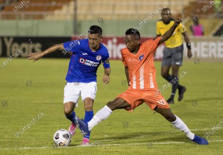 Stock Image of Elias Hernandez (L) of Cruz Azul in action against Louis-Jean Wendy (R) of Arcahaie during the CONCACAF Champions League soccer match between Cruz Azul and Arcahaie at the Felix Sanchez Stadium in Santo Domingo, Dominican Republic, 06 April 2021.