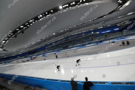 Chinese skaters Hou Kaibo, right, and Yahefu Aipeierding compete in the men's 500 meters race during a test event for the 2022 Beijing Winter Olympics at the National Speed Skating Oval in Beijing, . The organizers of the 2022 Beijing Winter Olympics has started 10 days of testing for several sport events in five different indoor venues from April 1-10, becoming the first city to hold both the Winter and Summer Olympics