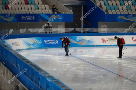 Workers resurface the ice after the men's 500 meter race during a test event for the 2022 Beijing Winter Olympics at the National Speed Skating Oval in Beijing, . The organizers of the 2022 Beijing Winter Olympics has started 10 days of testing for several sport events in five different indoor venues from April 1-10, becoming the first city to hold both the Winter and Summer Olympics