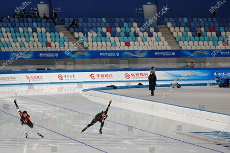 Chinese skaters Hou Kaibo, left, and Yahefu Aipeierding compete in the men's 500 meter race during a test event for the 2022 Beijing Winter Olympics at the National Speed Skating Oval in Beijing, . The organizers of the 2022 Beijing Winter Olympics has started 10 days of testing for several sport events in five different indoor venues from April 1-10, becoming the first city to hold both the Winter and Summer Olympics