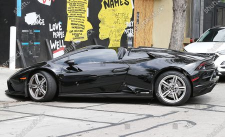 Vanessa Hudgens driving a black Lamborghini car