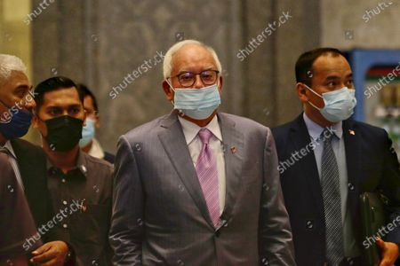 Malaysia's former prime minister Najib Razak (C) arrives at the Court of Appeal in Putrajaya, Malaysia, 07 April 2021. Malaysia's Court of Appeal continues hearing a bid by Najib to set aside his conviction on corruption charges in a case linked to a multibillion-dollar scandal at state fund 1Malaysia Development Berhad (1MDB).