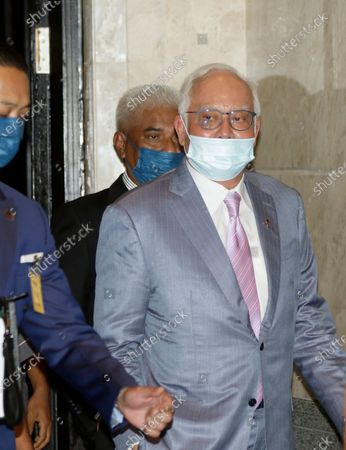 Malaysia's former prime minister Najib Razak (R) arrives at the Court of Appeal in Putrajaya, Malaysia, 07 April 2021. Malaysia's Court of Appeal continues hearing a bid by Najib to set aside his conviction on corruption charges in a case linked to a multibillion-dollar scandal at state fund 1Malaysia Development Berhad (1MDB).