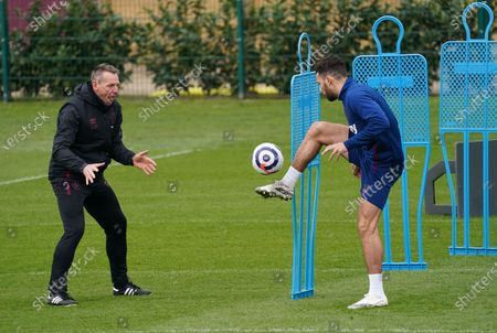 Ryan Fredericks of West Ham with coach Stuart Pearce during the training session