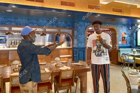 Chef Marcus Samuelsson and Miami Heat player Jimmy Butler at his new restaurant Red Rooster Overtown