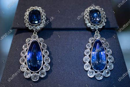 The Beauharnais sapphire and diamond earrings are seen during a viewing at Christie's auction house in Amsterdam, Netherlands, . The Beauharnais tiara and it's accompanying ring and earrings studded with diamonds and sapphires were in Amsterdam ahead of their auction next month in Geneva, the jewels once belonged to Napoleon Bonaparte's adopted daughter, Stephanie de Beauharnais, Grand Duchess of Baden