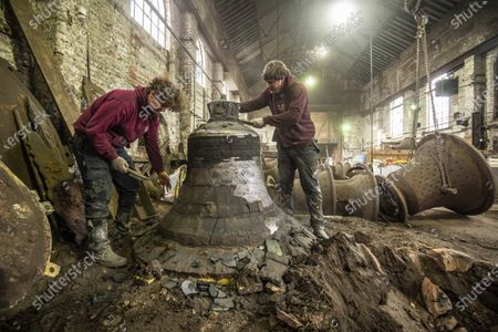John Taylor & Co. continues a line of bell founding which has been unbroken since the middle of the 14th Century, when Johannes de Stafford was active only 10 miles from the site of the present foundry.From 1784 the business was operated by members of the Taylor family, and in 1839 it moved to Loughborough as a condition of a contract to recast the Parish Church bells. The Foundry was moved to its present site in Loughborough in 1859, and is now proud to operate the largest bell foundry in the world.Taylorâ€s still make their bell moulds from the more labour intensive loam process as bell founders have done for centuries past. The making of the moulds takes a considerable amount of time as each layer is dried in a kiln overnight before the next is added, with all inscriptions and decoration being pressed into the final layer of wet loam as the mould is completed.  the worlds finest bell experts agree that the use of loam is a vital factor in producing the sweet toned bells for which the Foundry is known.Following traditional methods they also still dig a pit for each bell and bury  the moulds in the earth of the foundry floor before casting.  most bell founders abandoned the burying of their moulds to save time and money.  Taylors  are convinced that allowing the bell to cool slowly in the earth over a period of days gives a better molecular structure and a better sounding bell  Anthony Stone, Foundry Foreman and his apprentice Sam Armistad giving the newly dug up Liberty bell approx 1.2 tonnes in weight a quick clean before the the bell is tuned. This Liberty Bell is an exact copy of the original that was cast by the Whitechapel Foundry and Taylorâ€s will have to add a â€crack†to the bell to make it an exact replica before it goes to the client in the USA