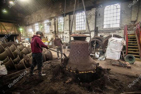 John Taylor & Co. continues a line of bell founding which has been unbroken since the middle of the 14th Century, when Johannes de Stafford was active only 10 miles from the site of the present foundry.From 1784 the business was operated by members of the Taylor family, and in 1839 it moved to Loughborough as a condition of a contract to recast the Parish Church bells. The Foundry was moved to its present site in Loughborough in 1859, and is now proud to operate the largest bell foundry in the world.Taylor's still make their bell moulds from the more labour intensive loam process as bell founders have done for centuries past. The making of the moulds takes a considerable amount of time as each layer is dried in a kiln overnight before the next is added, with all inscriptions and decoration being pressed into the final layer of wet loam as the mould is completed.  the worlds finest bell experts agree that the use of loam is a vital factor in producing the sweet toned bells for which the Foundry is known.Following traditional methods they also still dig a pit for each bell and bury  the moulds in the earth of the foundry floor before casting.  most bell founders abandoned the burying of their moulds to save time and money.  Taylors  are convinced that allowing the bell to cool slowly in the earth over a period of days gives a better molecular structure and a better sounding bell  Anthony Stone, Foundry Foreman and his apprentice Sam Armistad craning the newly dug up Liberty bell out of the ground in its mould before the the bell is tuned. approx 1.2 tonnes in weight a quick clean before the the bell is tuned. This Liberty Bell is an exact copy of the original that was cast by the Whitechapel Foundry and Taylor's will have to add a 'crack' to the bell to make it an exact replica before it goes to the client in the USA