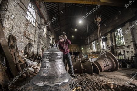 John Taylor & Co. continues a line of bell founding which has been unbroken since the middle of the 14th Century, when Johannes de Stafford was active only 10 miles from the site of the present foundry.From 1784 the business was operated by members of the Taylor family, and in 1839 it moved to Loughborough as a condition of a contract to recast the Parish Church bells. The Foundry was moved to its present site in Loughborough in 1859, and is now proud to operate the largest bell foundry in the world.Taylor's still make their bell moulds from the more labour intensive loam process as bell founders have done for centuries past. The making of the moulds takes a considerable amount of time as each layer is dried in a kiln overnight before the next is added, with all inscriptions and decoration being pressed into the final layer of wet loam as the mould is completed.  the worlds finest bell experts agree that the use of loam is a vital factor in producing the sweet toned bells for which the Foundry is known.Following traditional methods they also still dig a pit for each bell and bury  the moulds in the earth of the foundry floor before casting.  most bell founders abandoned the burying of their moulds to save time and money.  Taylors  are convinced that allowing the bell to cool slowly in the earth over a period of days gives a better molecular structure and a better sounding bell  Anthony Stone, Foundry Foreman giving the newly dug up Liberty bell approx 1.2 tonnes in weight a quick clean before the the bell is tuned. This Liberty Bell is an exact copy of the original that was cast by the Whitechapel Foundry and Taylor's will have to add a 'crack' to the bell to make it an exact replica before it goes to the client in the USA
