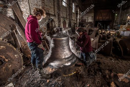 John Taylor & Co. continues a line of bell founding which has been unbroken since the middle of the 14th Century, when Johannes de Stafford was active only 10 miles from the site of the present foundry.From 1784 the business was operated by members of the Taylor family, and in 1839 it moved to Loughborough as a condition of a contract to recast the Parish Church bells. The Foundry was moved to its present site in Loughborough in 1859, and is now proud to operate the largest bell foundry in the world.Taylorâ€s still make their bell moulds from the more labour intensive loam process as bell founders have done for centuries past. The making of the moulds takes a considerable amount of time as each layer is dried in a kiln overnight before the next is added, with all inscriptions and decoration being pressed into the final layer of wet loam as the mould is completed.  the worlds finest bell experts agree that the use of loam is a vital factor in producing the sweet toned bells for which the Foundry is known.Following traditional methods they also still dig a pit for each bell and bury  the moulds in the earth of the foundry floor before casting.  most bell founders abandoned the burying of their moulds to save time and money.  Taylors  are convinced that allowing the bell to cool slowly in the earth over a period of days gives a better molecular structure and a better sounding bell  Anthony Stone Foundry Foreman and his apprentice Sam Armistad cleaning the newly dug up Liberty bell  approx 1.2 tonnes in weight a quick clean before the the bell is tuned. This Liberty Bell is an exact copy of the original that was cast by the Whitechapel Foundry and Taylorâ€s will have to add a â€crack†to the bell to make it an exact replica before it goes to the client in the USA