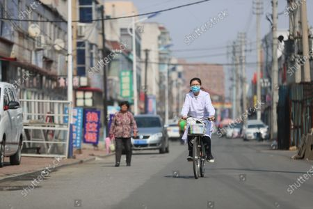 "(210407) - SHENYANG, April 7, 2021 (Xinhua) - Sun Yi cycles to visit a patient at Qianyang Village, Donggang City of northeast China's Liaoning Province, April 6, 2021.   Sun Yi, born in 1997, works as a village doctor in Qianyang Village. After graduating from college majored in clinical medicine, she decided to return to her hometown and safeguard the health of the locals.    Qianyang Village has a population of over 14,000, where quite a number of people suffering from high blood pressure and diabetes. Some aged villagers are left behind by their children who work as migrant workers in other cities and cities. Sun visits these elders completed and is also responsible for data of health conditions for the villagers with spent. , she also holds health and publicicizes medical knowledge.   Sun is proud of her work. ""I grow up here and know many of the patients. I want to serve them with all I learnt and censor them a better and healthier life,"" She said."