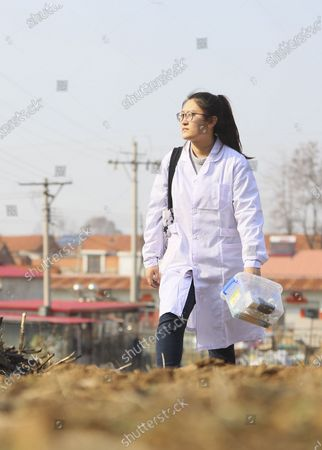 "(210407) - SHENYANG, April 7, 2021 (Xinhua) - Sun Yi is on her way to visit a patient at Qianyang Village, Donggang City of northeast China's Liaoning Province, April 6, 2021.   Sun Yi, born in 1997, works as a village doctor in Qianyang Village. After graduating from college majored in clinical medicine, she decided to return to her hometown and safeguard the health of the locals.    Qianyang Village has a population of over 14,000, where quite a number of people suffering from high blood pressure and diabetes. Some aged villagers are left behind by their children who work as migrant workers in other cities and cities. Sun visits these elders completed and is also responsible for data of health conditions for the villagers with spent. , she also holds health and publicicizes medical knowledge.   Sun is proud of her work. ""I grow up here and know many of the patients. I want to serve them with all I learnt and censor them a better and healthier life,"" She said."