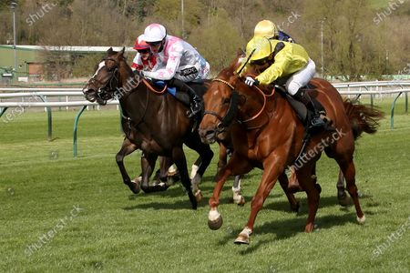 Stock Photo of BATRAAN (9) ridden by Gavin Ashton and trained by Roger Varian winning the Mansionbet Watch And Bet Handicap over 5f  at Nottingham Racecourse, Nottingham