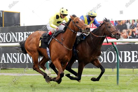 ASTRO KING (4), on the far side, ridden by Richard Kingscote and trained by Sir Michael Stoute winning the Class 3 Download The Mansionbet App Handicap over 1m at Nottingham Racecourse, Nottingham