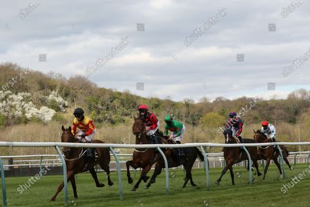 The eventual winner SIR RON PRIESTLEY ridden by Franny Norton lead the field on the first circuit of the Listed Mansionbet Barry Hill Further Flight Stakes over 1m 6f at Nottingham Racecourse, Nottingham