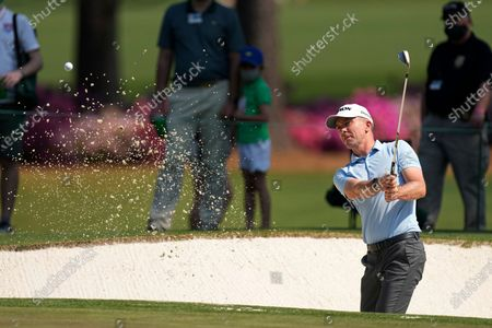Martin Laird, of Scotland, hits out of a bunker on the 15th hole during a practice round for the Masters golf tournament, in Augusta, Ga