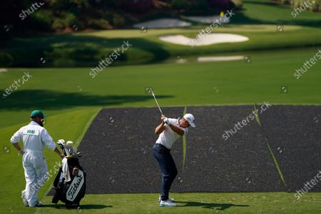Henrik Stenson, of Sweden, tees off on the 12th hole during a practice round for the Masters golf tournament, in Augusta, Ga