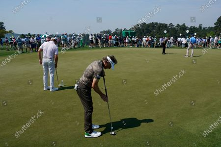 Bernhard Langer, of Germany, putts on the practice green during a practice round for the Masters golf tournament, in Augusta, Ga