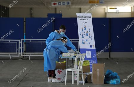 Medical workers conduct a rapid coronavirus test at the CyprusExpo in Nicosia. Cyprus, Wednesday, April 7, 2021. Today Cyprus' president Nikos Anastasiades visited the Vaccination Center at CyprusExpo.