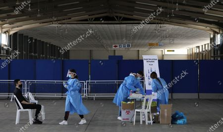 Stock Photo of Medical workers conduct a rapid coronavirus test at the CyprusExpo in Nicosia. Cyprus, Wednesday, April 7, 2021. Today Cyprus' president Nikos Anastasiades visited the Vaccination Center at CyprusExpo.
