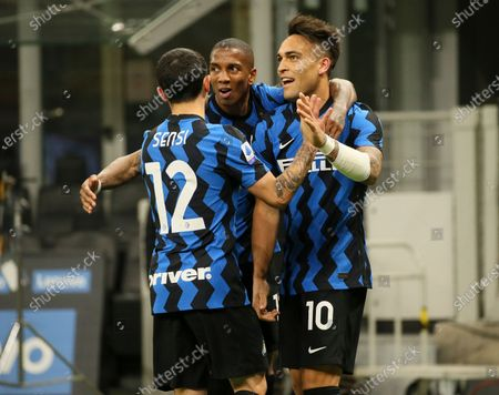 Lautaro Martinez (R) of FC Internazionale celebrates with Stefano Sensi (L) and Ashley Young (C) after scoring the his team's second goal during the Serie A match between FC Internazionale and US Sassuolo at Stadio Giuseppe Meazza on April 07, 2021 in Milan, Italy. Sporting stadiums around Italy remain under strict restrictions due to the Coronavirus Pandemic as Government social distancing laws prohibit fans inside venues resulting in games being played behind closed doors.