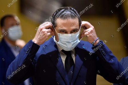 Lebanese Prime Minister-designate Saad Hariri wears a face mask as he waits to welcome Egyptian Foreign Minister Sameh Shoukry before their meeting at his house in Beirut, Lebanon, 07 April 2021. Shoukry arrived in Beirut for an official visit during which he will meet with Lebanese officials.