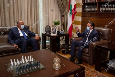 Outgoing Prime Minister Saad Hariri, right, meets with Egyptian Foreign Minister Sameh Shukry at the prime minister's house in downtown Beirut, Lebanon