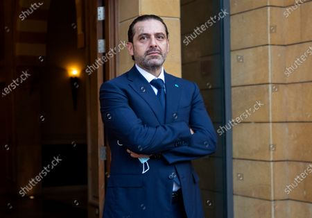 Outgoing Prime Minister Saad Hariri waits to welcome Egyptian Foreign Minister Sameh Shukry before their meeting at his house in downtown Beirut, Lebanon
