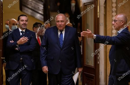 Egyptian Foreign Minister Sameh Shukry, center, arrives to a press conference after his meeting with outgoing Prime Minister Saad Hariri, left, at his house in downtown Beirut, Lebanon