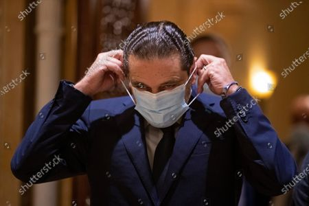 Outgoing Prime Minister Saad Hariri puts on his mask after his meeting with Egyptian Foreign Minister Sameh Shukry at his house in downtown Beirut, Lebanon