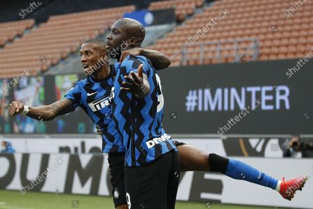 Inter Milan's Romelu Lukaku, right, celebrates with his teammate Ashley Young, after scores against Sassuolo during the Serie A soccer match between Inter Milan and Sassuolo at the San Siro Stadium in Milan, Italy