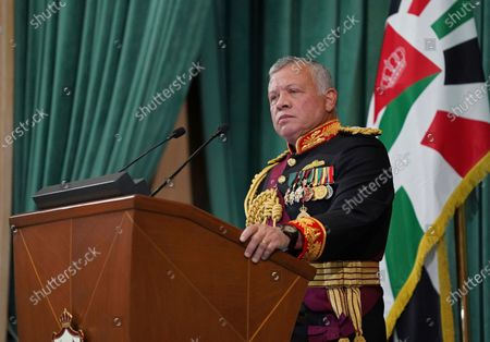 """Released by the Royal Hashemite Court, Jordan's King Abdullah II gives a speech during the inauguration of the 19th Parliament's non-ordinary session, in Amman Jordan. Jordan's king addressed the public feud with his half-brother, Prince Hamzah, portraying it as an attempted """"sedition"""" that caused him shock, anger and pain. The statement, carried by Jordan TV, marked the first time King Abdullah II addressed the unprecedented rift in the royal family which erupted over the weekend"""