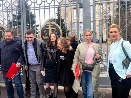 From left, Nikolai Lyaskin, a member of Alexei Navalny team, Moscow municipal deputy Konstantin Yankauskas, Moscow municipal deputy Lyudmila Stein, Masha Alekhina, member of Russian punk collective Pussy Riot, Anastasia Vasilyeva, the Alliance of Doctors union's leader, Russian opposition activist Lyubov Sobol, stand in front of the Moscow City court in Moscow, Russia, . Moscow court considers appeals against the extension of house arrest for several associates of Russian opposition leader Alexei Navalny, including his brother Oleg Navalny and opposition politician Lyubov Sobol