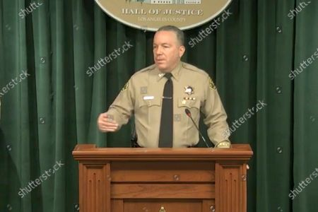 In this image take from a livestream video feed provided by the Los Angeles County Sheriff's Department, Sheriff Alex Villanueva speaks during a news conference in Los Angeles, about the Tiger Woods' accident. Authorities say Woods was speeding when he crashed an SUV in Southern California less than two months ago, leaving him seriously injured