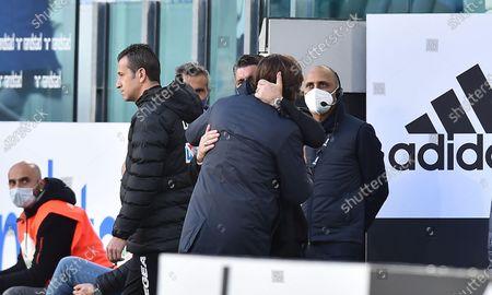 Juventus' coach Andrea Pirlo (C-R) embraces Napoli's coach Gennaro Gattuso (C-L) prior to the Italian Serie A soccer match Juventus FC vs SSC Napoli at the Allianz Stadium in Turin, Italy, 07 April 2021.