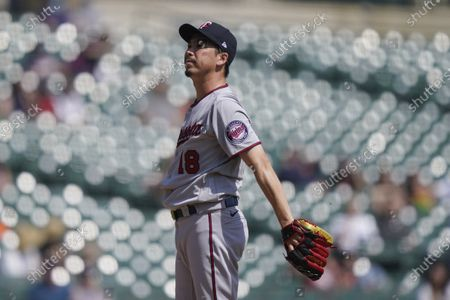Minnesota Twins starting pitcher Kenta Maeda reacts after giving up a solo home run to Detroit Tigers' Wilson Ramos during the fifth inning of a baseball game, in Detroit