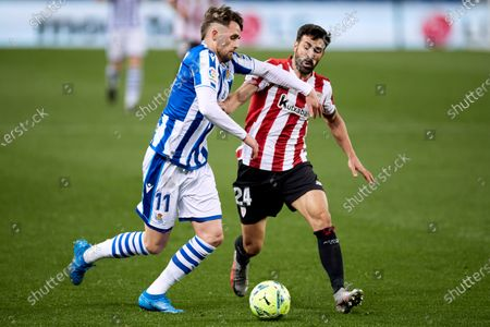 Adnan Januzaj of Real Sociedad CF competes for the ball with Mikel Balenziaga of Athletic Club during the La Liga match between Real Sociedad CF and Athletic Club at Reale Arena on April 07, 2021 in San Sebastian, Spain.