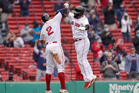 Boston Red Sox's Christian Vazquez celebrates his two-run homer with teammate Xander Bogaerts (2) in the fourth inning of a baseball game against the Tampa Bay Rays at Fenway Park, in Boston