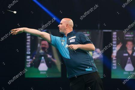 Rob Cross throws during the Unibet PDC Premier League of darts at Marshalls Arena, Stadium MK, Milton Keynes