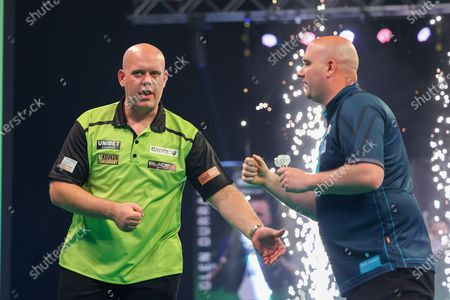 Michael van Gerwen acknowledges his opponent Rob Cross at the end of the match during the Unibet PDC Premier League of darts at Marshalls Arena, Stadium MK, Milton Keynes