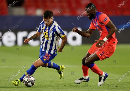 Porto's midfielder Otavio (L) vies for the ball against Chelsea's defender Antonio Rudiger (R) during the UEFA Champions League quarterfinal first leg soccer match between FC Porto and Chelsea FC at Ramon Sanchez Pizjuan stadium in Seville, Andalusia, Spain, 07 April 2021.