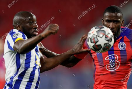 Porto's striker Mousa Marega (L) vies for the ball against Chelsea's defender Antonio Rudiger (R) during the UEFA Champions League quarterfinal first leg soccer match between FC Porto and Chelsea FC at Ramon Sanchez Pizjuan stadium in Seville, Andalusia, Spain, 07 April 2021.