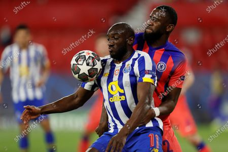 Porto's striker Moussa Marega (L) vies for the ball against Chelsea's defender Antonio Rudiger (R) during the UEFA Champions League quarterfinal first leg soccer match between FC Porto and Chelsea FC at Ramon Sanchez Pizjuan stadium in Seville, Andalusia, Spain, 07 April 2021.