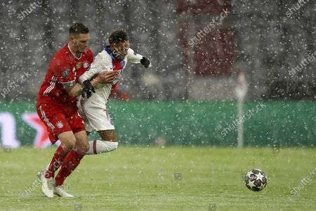 Bayern's Niklas Suele, left, stops PSG's Neymar during the Champions League quarterfinal soccer match between Bayern Munich and Paris Saint Germain in Munich, Germany