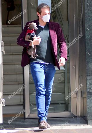 Tomaso Trussardi returns to work after celebrating his 38th  birthday seen here with his greyhound Odino