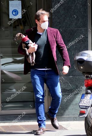 Stock Picture of Tomaso Trussardi returns to work after celebrating his 38th  birthday seen here with his greyhound Odino